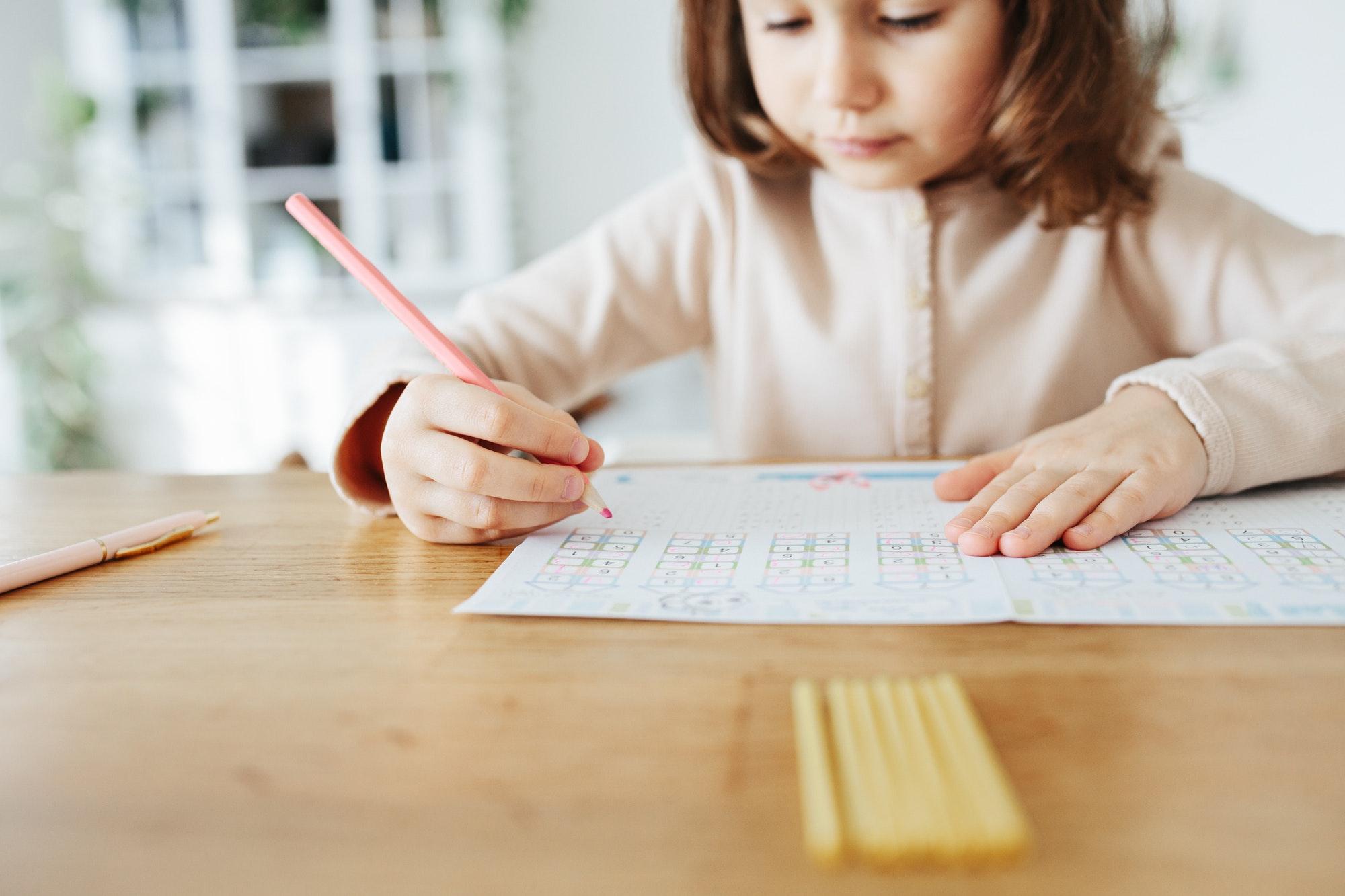 Cute five years girl learning home.